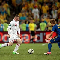 England's Wayne Rooney in action with Ukraine's Bohdan Butko