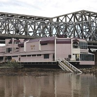 A bridge prevented the Waterfront restaurant from floating further downstream in Covington, Kentucky