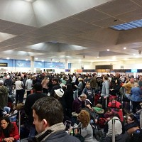 "Passengers waiting at the North Terminal at Gatwick Airport, as passengers were left ""in limbo"" at the airport's North Terminal"
