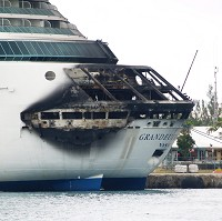 The fire-damaged exterior of Royal Caribbean's Grandeur of the Seas cruise ship (AP/The Freeport News, Jenneva Russell)