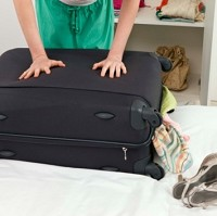 Women play a bigger role in holiday packing, a poll has claimed