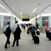 Passengers walk through the south terminal station of the Gatwick Shuttle inter-terminal transit train