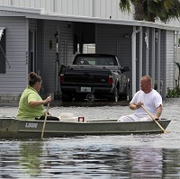 Rains from Tropical Storm Debby floods streets in Florida (AP Photo/John Raoux)
