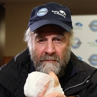 Nursing his wounds: Sir Ranulph addresses a Heathrow Airport hotel press conference after flying back from his Coldest Journey expedition