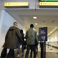 Passengers in Terminal 3 at Heathrow Airport, as plane arrivals and take-offs at Britain's two biggest airports were largely unaffected by today's strike, with just a few cancellations of inbound transatlantic flights