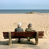 An older couple enjoy life on the beach as a report reveals the over-60s are the happiest age group in the UK