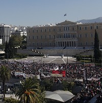 Thousands of protesters gather outside the Greek Parliament in Athens on Thursday (AP)