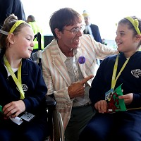 Sir Cliff Richard meets Tegan Badger-Osmond (left) from Swansea and Connie Taylor-Bates from Worcester before boarding the Dreamflight plane
