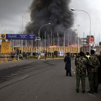 Police stand guard following a fire at the international arrivals unit of Jomo Kenyatta International Airport, Nairobi, Kenya (AP)