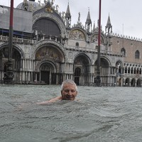 High tides have flooded Venice, leading Venetians and tourists to don high boots and use wooden walkways to cross St. Mark's Square