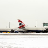 Planes standing in the snow at Heathrow Airport