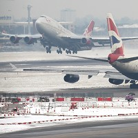 Planes take off and taxi at Heathrow Airport as the winter weather continued across the UK