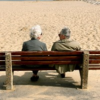 An elderly couple enjoy the sunshine