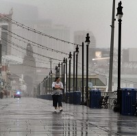 Flights to the US have been cancelled as America's east coast braces itself for the arrival of Hurricane Sandy (AP)