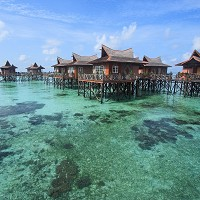 Resorts such as this one on Mabul Island are why tourists are drawn to Malaysia.