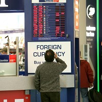 Collapsing currencies could spell bad news for some tourists looking at exchange rate boards this Easter