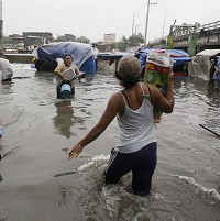The Philippines were struck by Typhoon Nesat which brought floods and caused at least one death