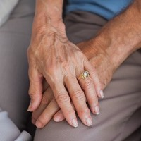 People who are married when diagnosed with cancer live longer than those who are not, a study suggests