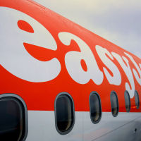 Two passengers were asked to leave an overbooked easyJet flight,  it is reported