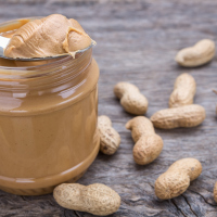 Symptoms of an allergic reaction to peanuts include itching in the mouth, a rash, swelling in the face, mouth and throat, shortness of breath and feeling dizzy.