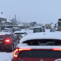 Cars stuck in the heavy snow