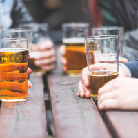 Exceeding 350g of alcohol every week could shed four to five years off their life.