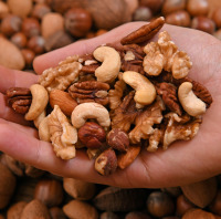 Nuts can help reduce the risk of suffering serious illness, say researchers