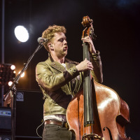 Ted Dwane is the bassist of Mumford and Sons