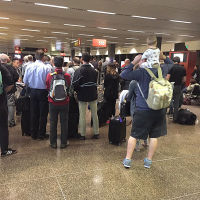 People queuing at Seattle Tacoma International Airport in the USA after an IT glitch hit British Airways check-in systems.