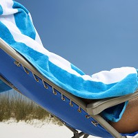 Covering up: but medical experts suggests that holidaymakers should also check for skin changes and abnormalities too