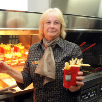 Jean Bulmer from Wales prepares French fries at McDonald's