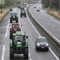 French farmers join the blockade from a motorway junction along the A16 near Calais, France, as part of a campaign for the Jungle migrant camp to be demolished.