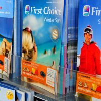 Holiday brochures for Thomson and First Choice, whose owner, tour operator TUI, has reported strong demand for trips abroad